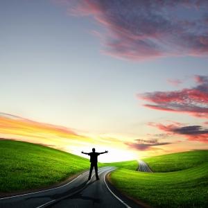 2414832-man-walking-away-at-dawn-along-road