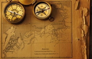 4829627-antique-compass-over-old-map (1)